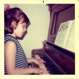 Young Stacy Robin playing piano